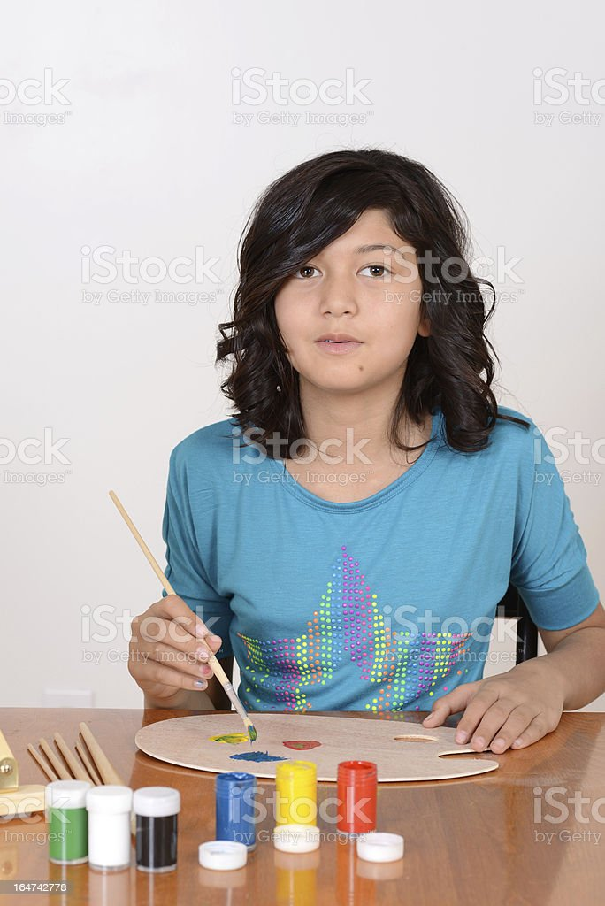 Young girl mixing art paints royalty-free stock photo