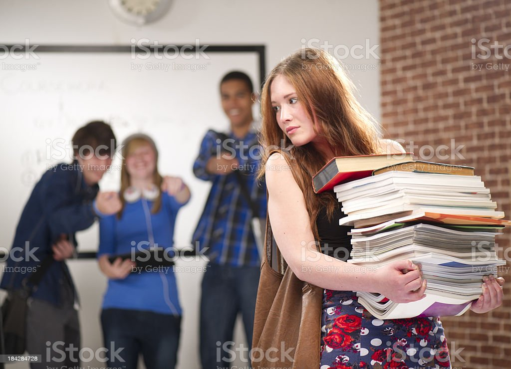 young girl mocked by classmates royalty-free stock photo