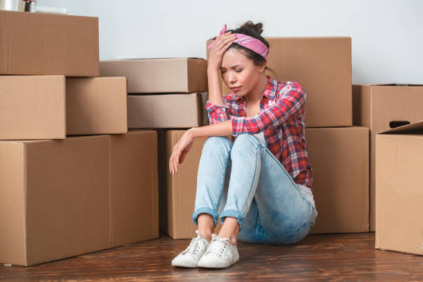 Young girl moving to new place sitting having headache unhappy picture id1131883311?b=1&k=6&m=1131883311&s=612x612&w=0&h=3gg47bvowj8m11vselkulufmasuks4qnwdbxocc9pl4=