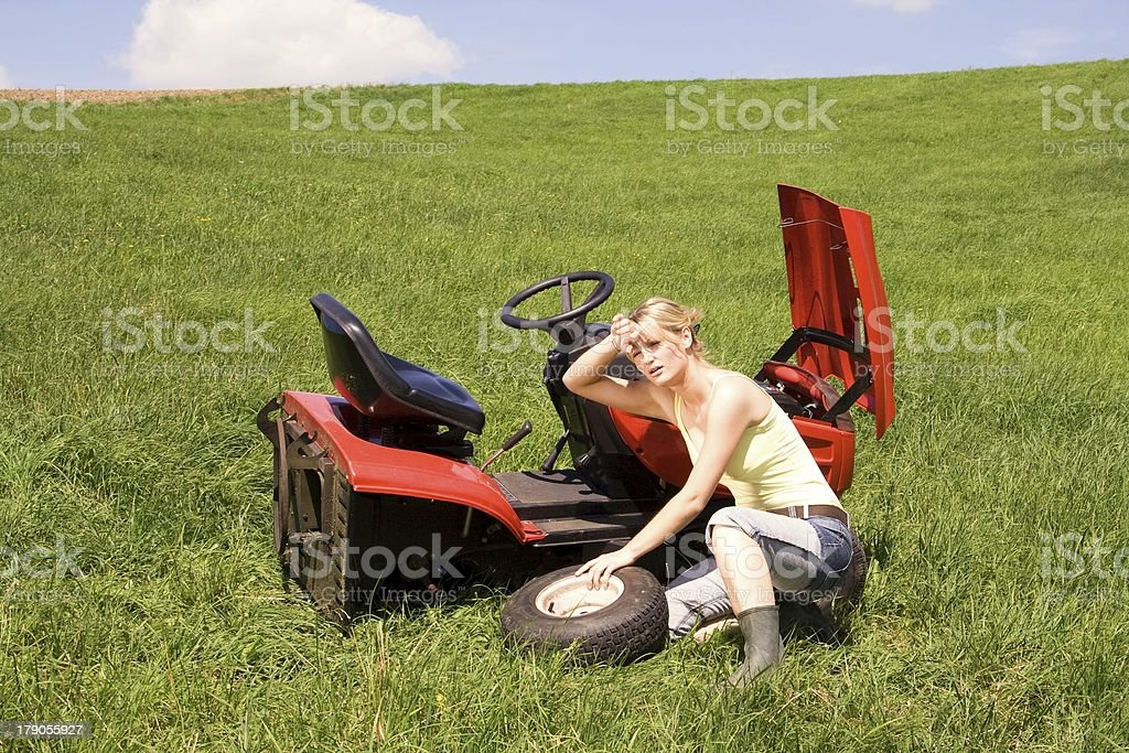 young girl mowing stock photo