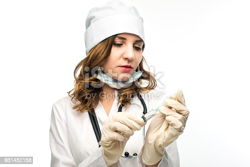 istock young girl nurse in glasses prepares syringe 931452158