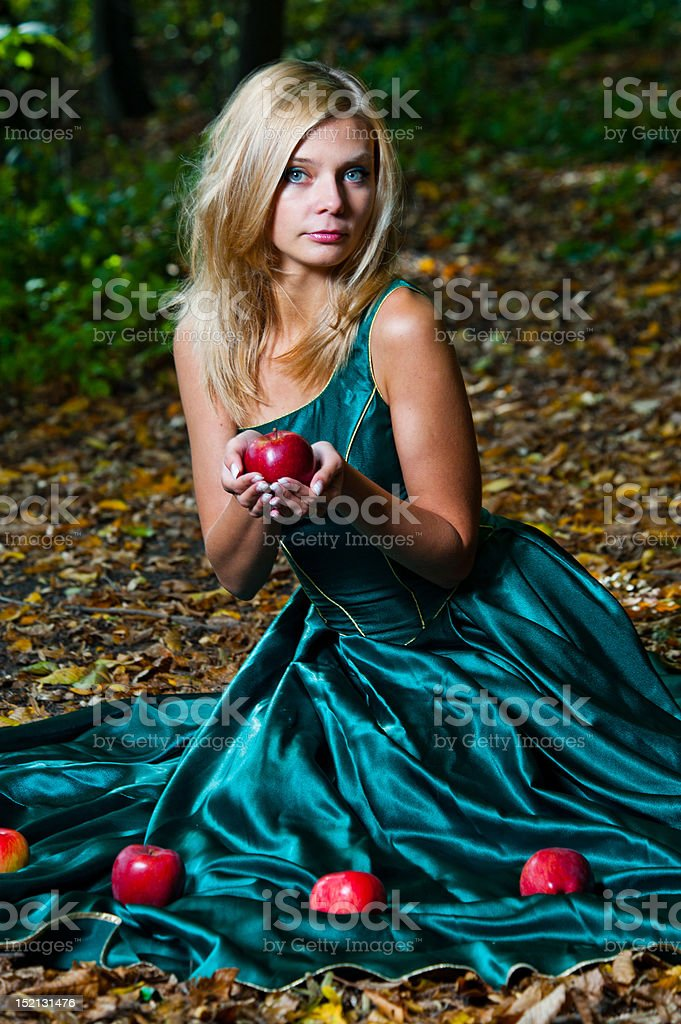 Young girl offering an apple royalty-free stock photo