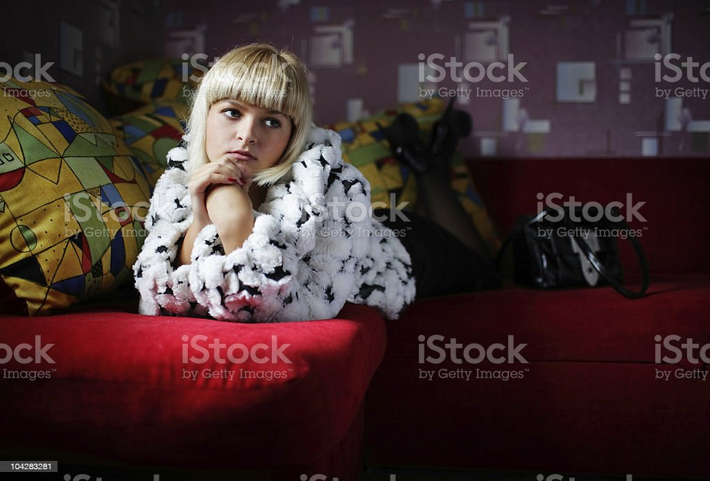 Young girl on a red sofa royalty-free stock photo