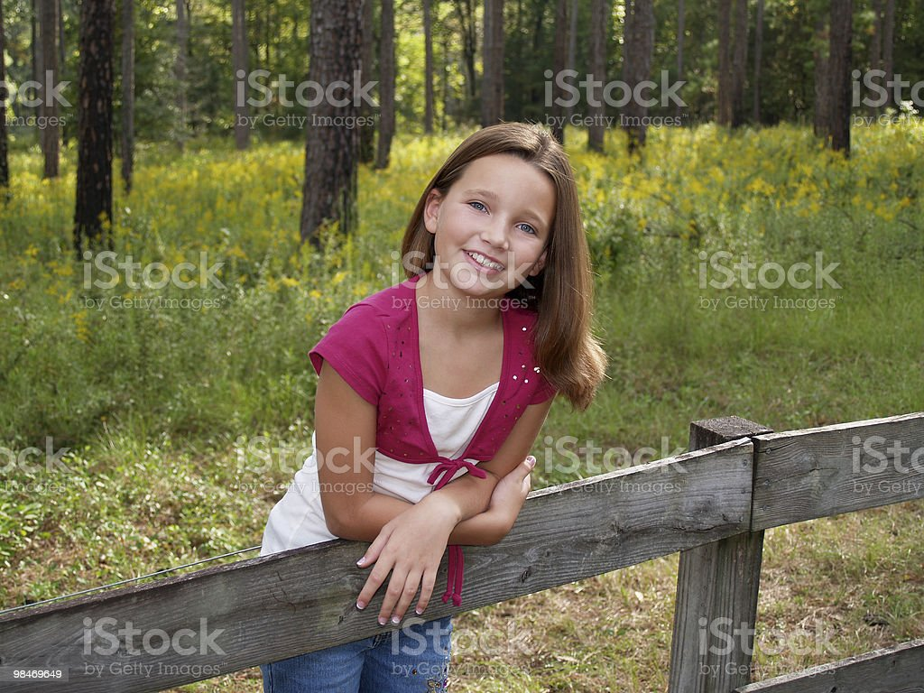 Young Girl on Fence royalty-free stock photo