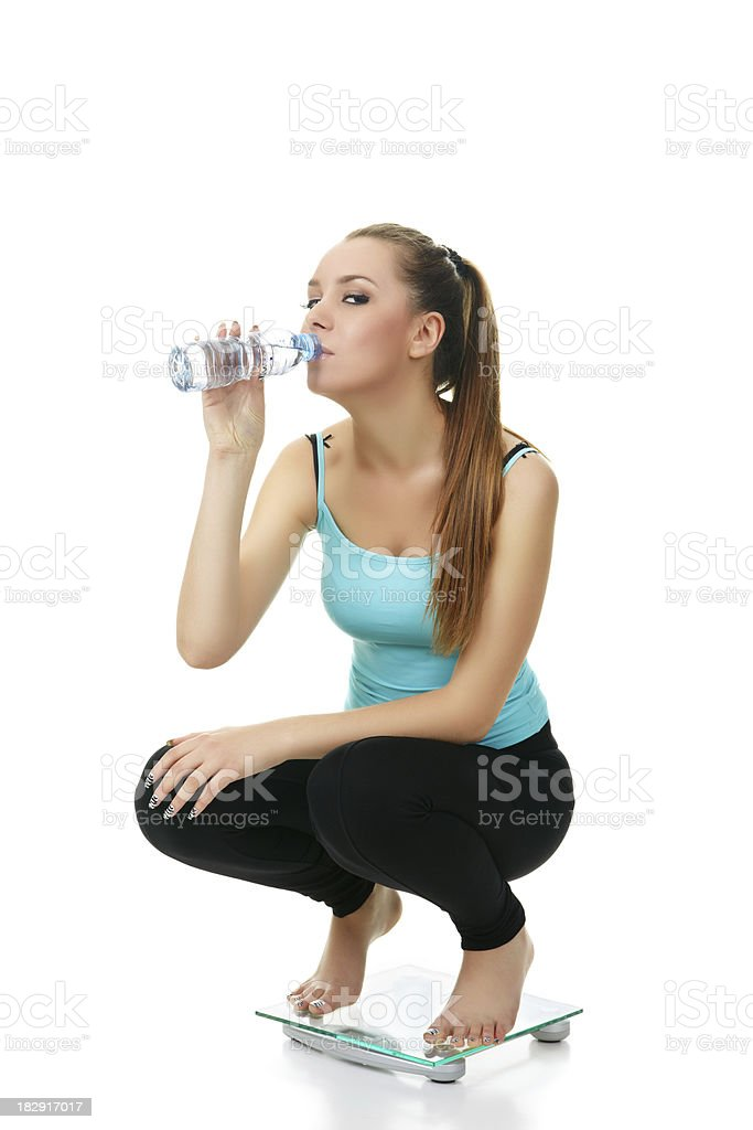 young girl on glass scale stock photo