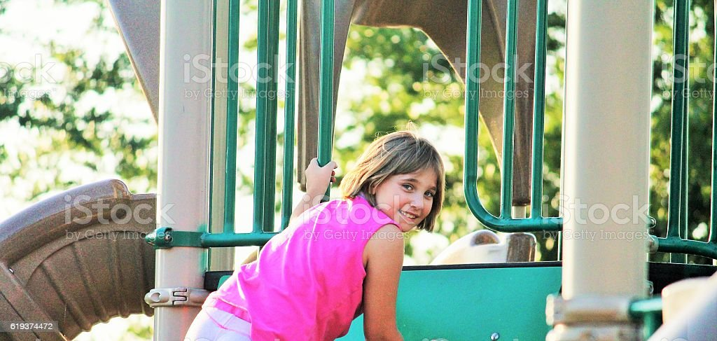 Young Girl on Playground stock photo