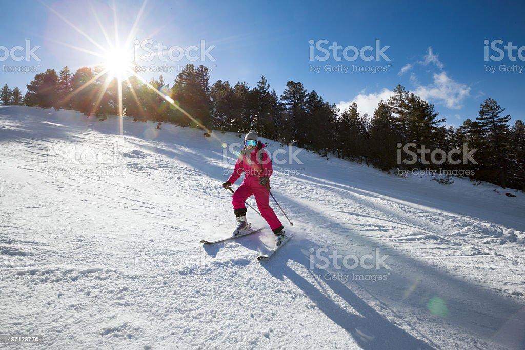 Young girl on skis stock photo