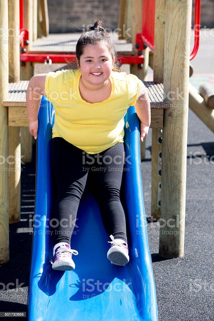 Young Girl On Slide stock photo