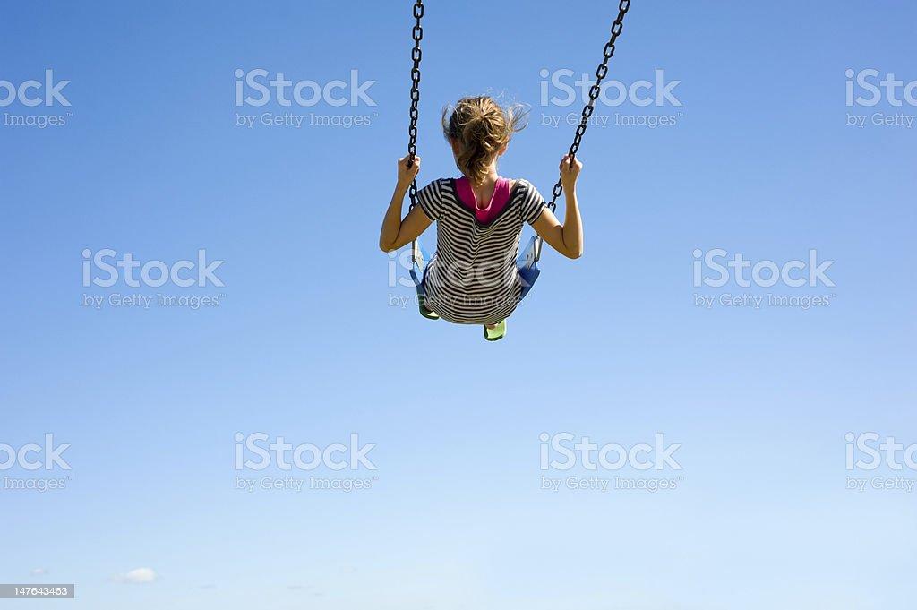Young Girl on Swing stock photo