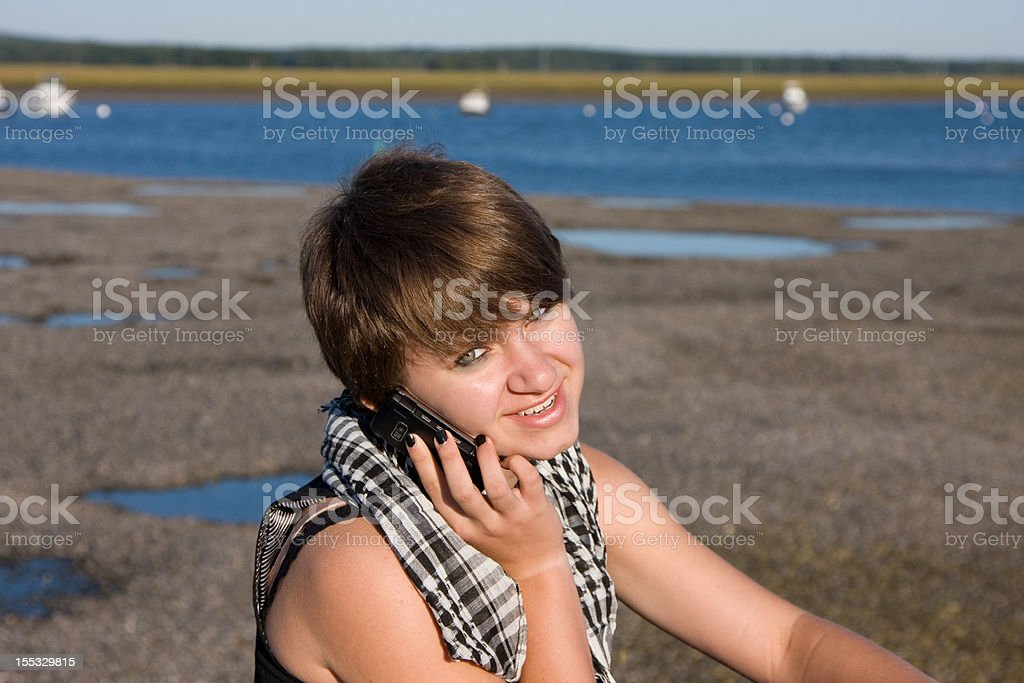 Young girl on the cell phone stock photo