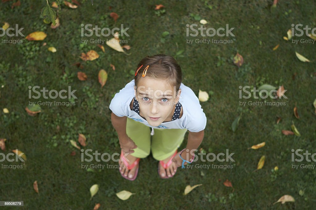Young girl on the grass royalty-free stock photo