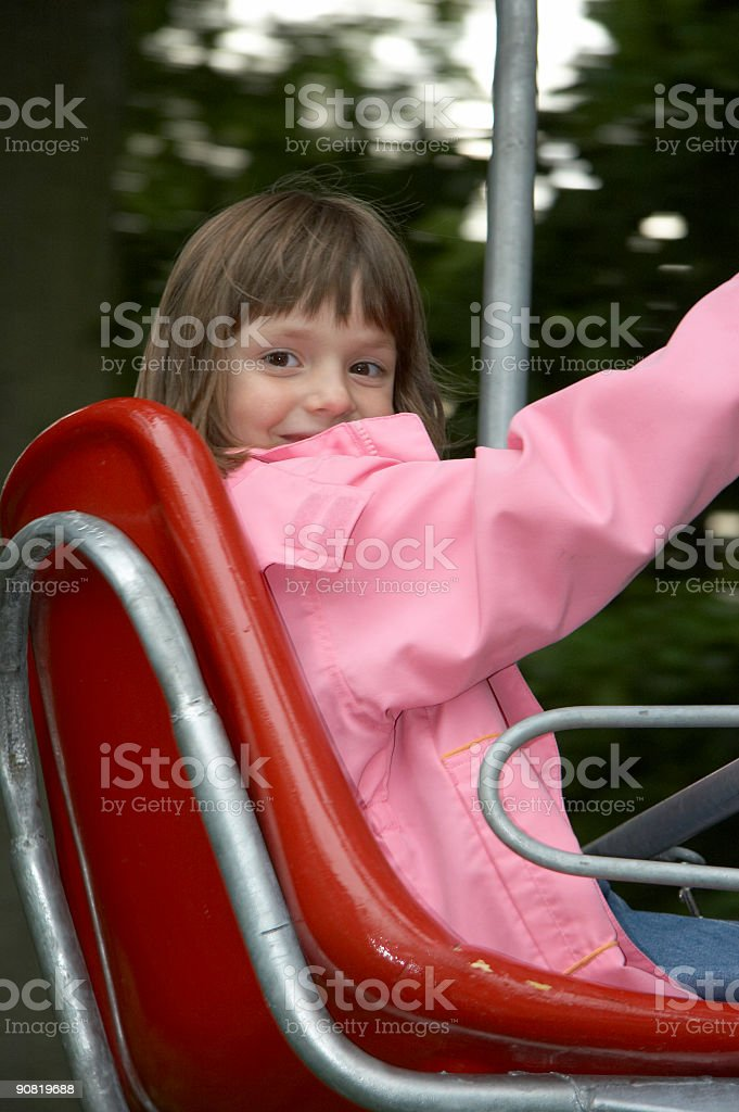 young girl on the playground-lift royalty-free stock photo