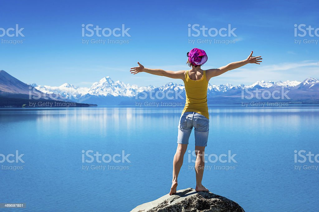 Young girl on the rock stock photo