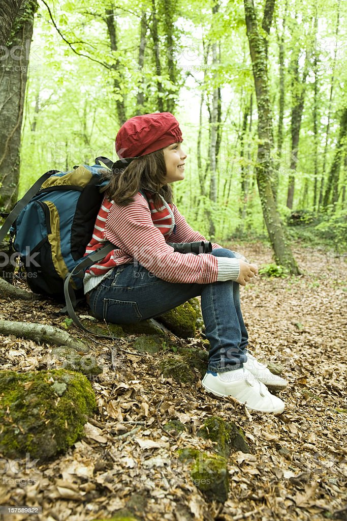 Young girl on trip field in the woods royalty-free stock photo