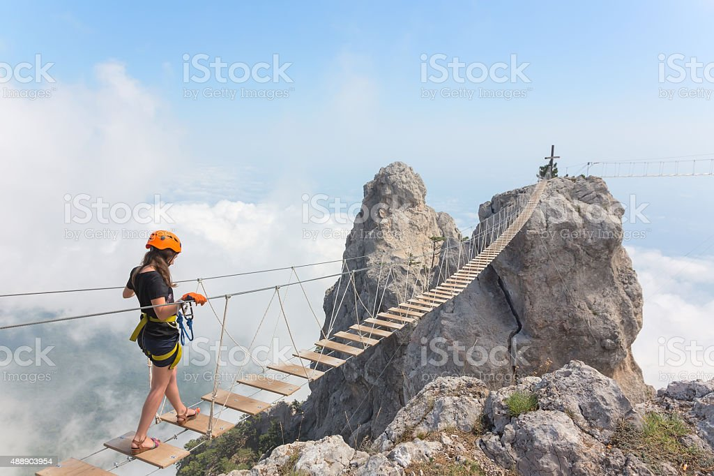 Young girl over abyss stock photo