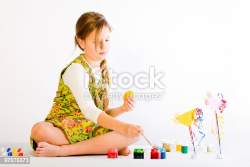 istock Young girl painting eggs 97626673
