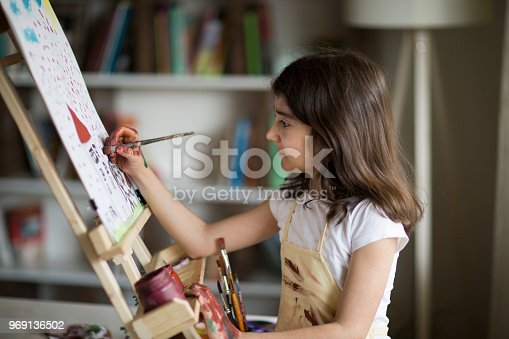 istock Young Girl Painting 969136502