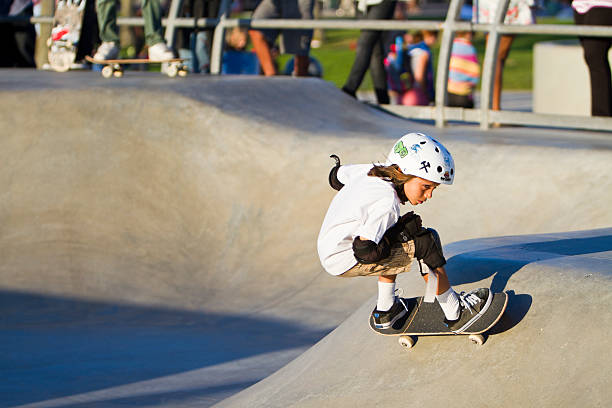 young girl performing in front of crowd at skateboard park - skatepark bildbanksfoton och bilder