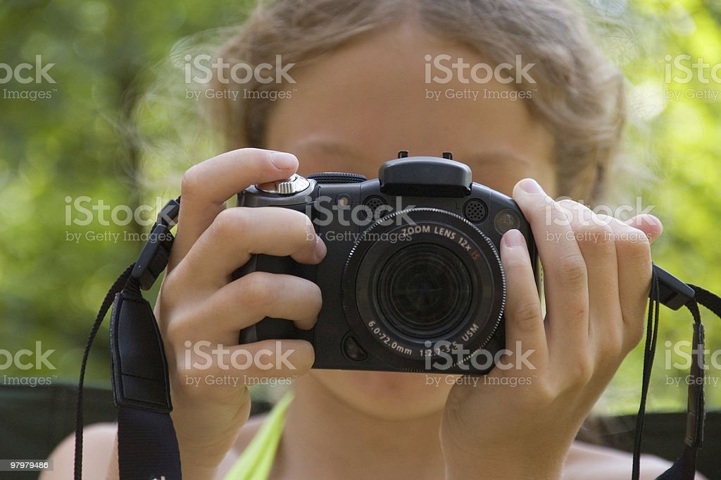 young girl photograph somebody with her camera royalty-free stock photo