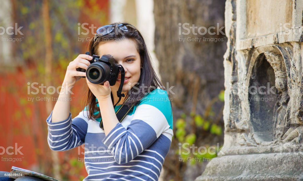young girl photographed in old city stock photo