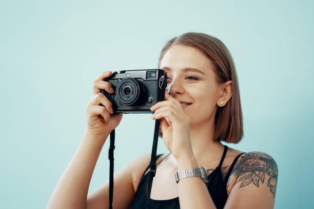 Young girl photographer taking photos on blue background picture id1222165509?b=1&k=6&m=1222165509&s=612x612&w=0&h=jvrdssdoju9fp22pb6v bitdyfckn1xukmqe6gnik28=