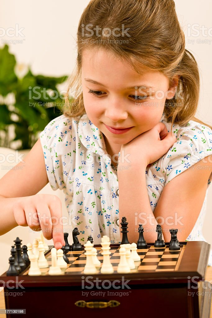 Young girl play chess cute smile royalty-free stock photo