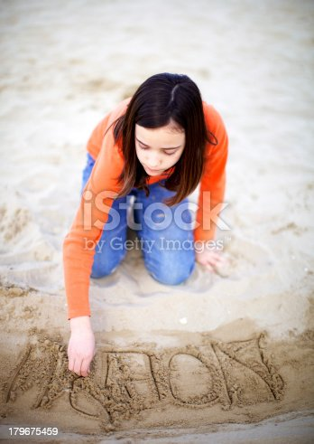 Young girl play on the beach