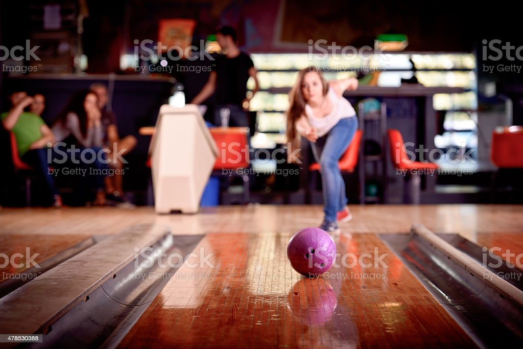 young girl playing bowling stok fotoğrafı