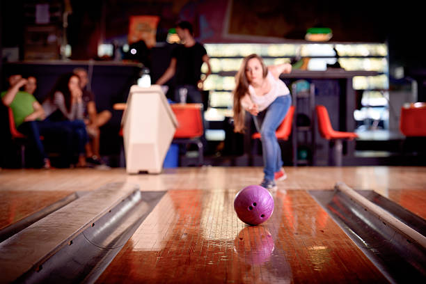 young girl playing bowling stock photo