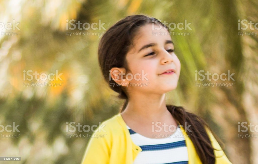 Young girl playing in a park stock photo