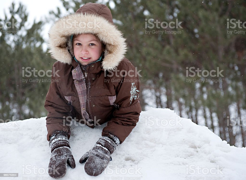 Young girl playing in the snow royalty-free stock photo
