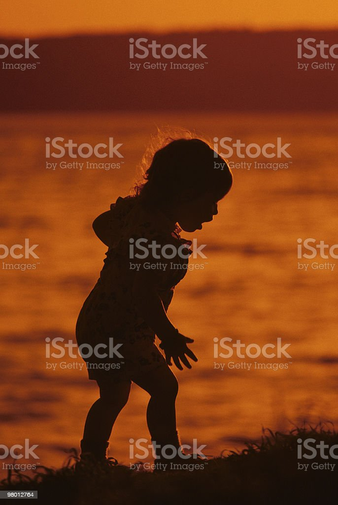 Young Girl Playing on the Beach at Sunset royalty-free stock photo