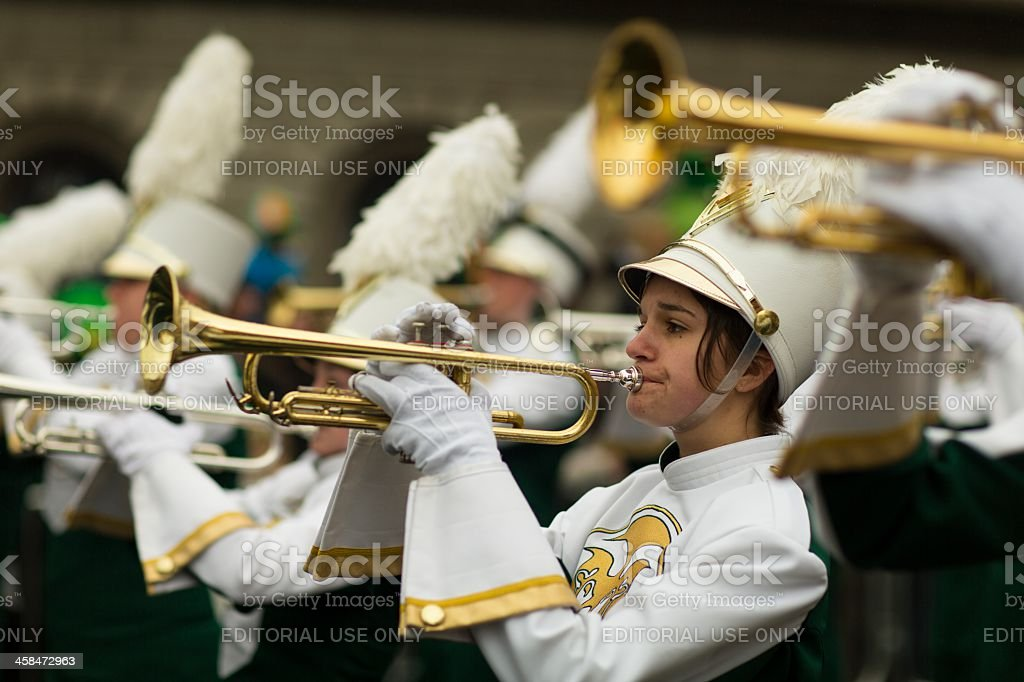 Young girl playing on trumpet royalty-free stock photo