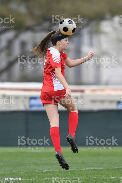 Young girl playing soccer kicking the ball during a game picture id1137557829?b=1&k=6&m=1137557829&s=612x612&h=ol21ifbjnvezunwjnpigwxftn48knln ziir2qy33zg=
