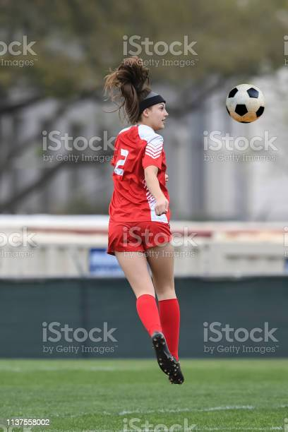 Young girl playing soccer kicking the ball during a game picture id1137558002?b=1&k=6&m=1137558002&s=612x612&h=yv2adyyf82gqxvxzqcgpameo2g2kta5d95t ojeovxy=