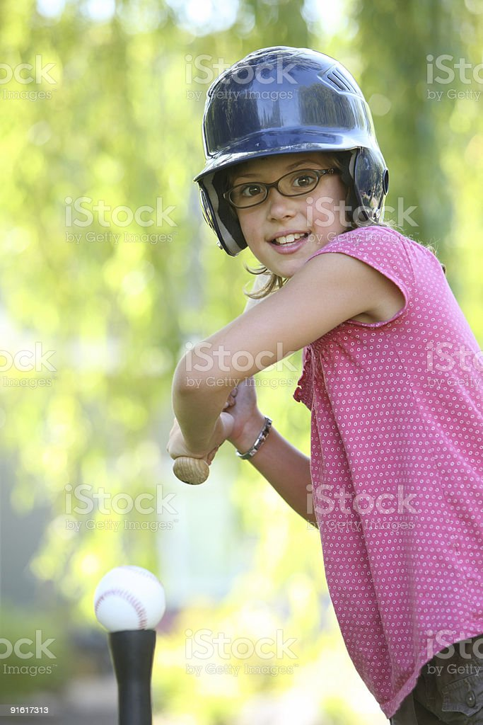 Young girl playing t-ball stock photo