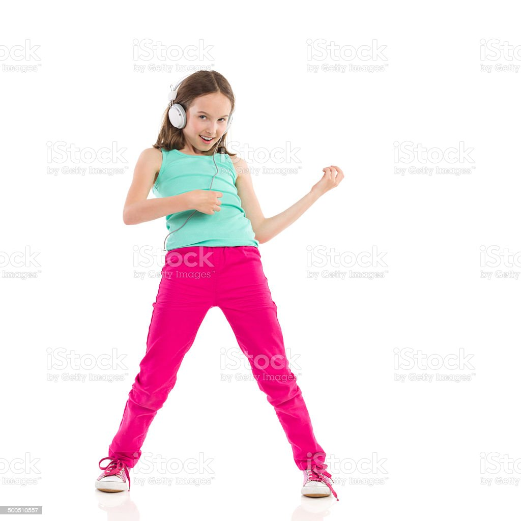 Young girl playing the air guitar stock photo