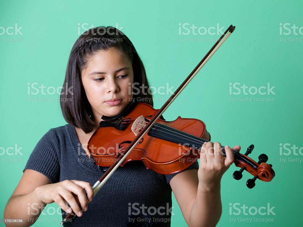 Young girl playing the violin. royalty-free stock photo