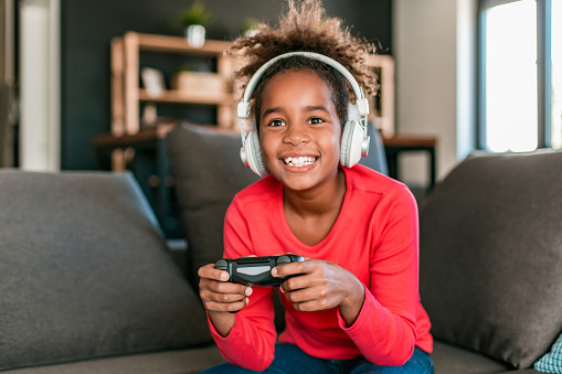 African American girl playing video games