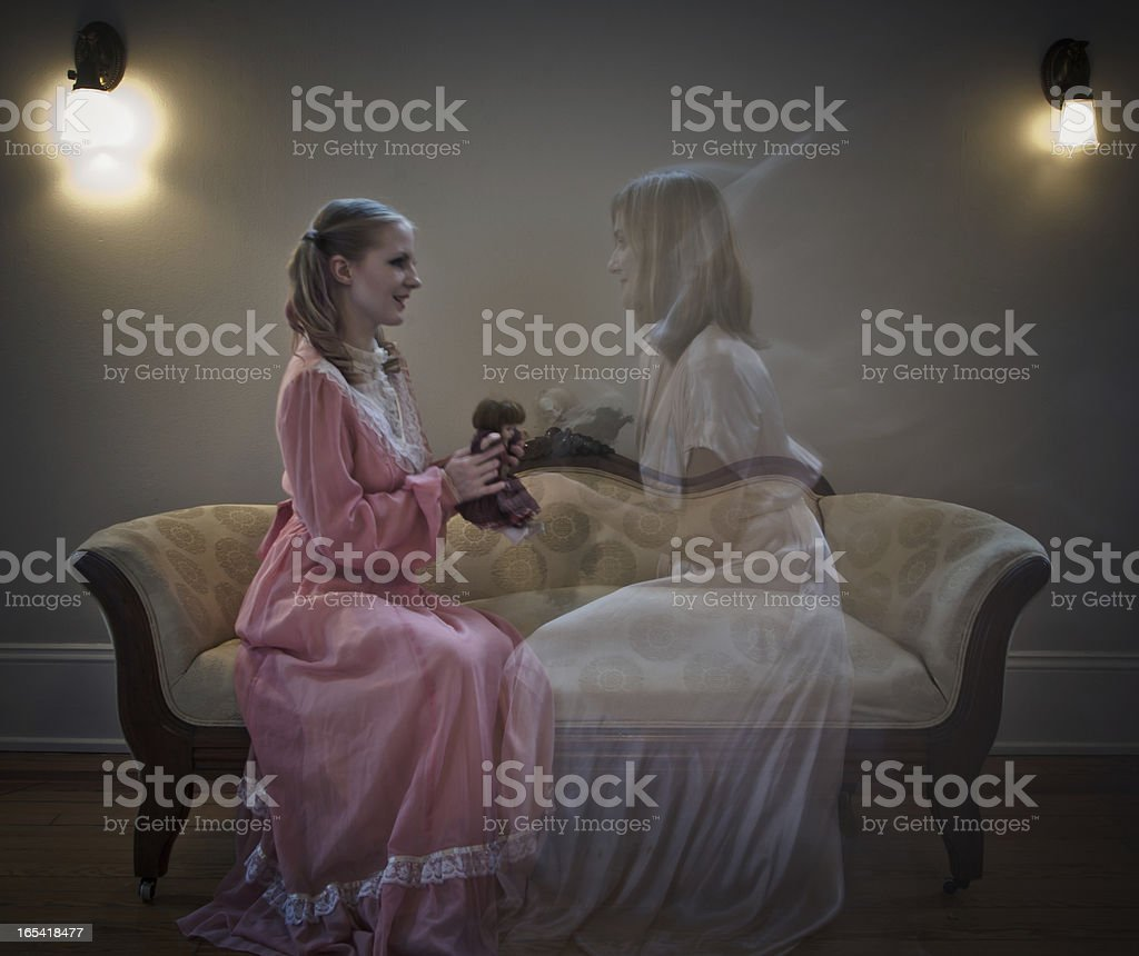 Young Girl Playing With Her Ghost Sister royalty-free stock photo