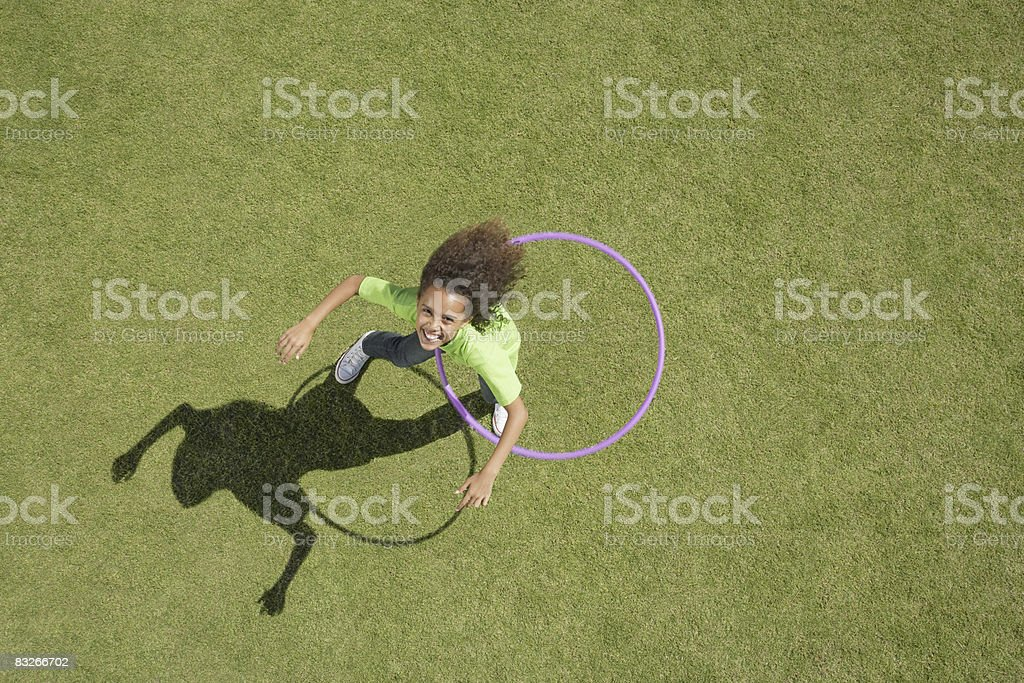 Young girl playing with hula hoop royalty-free stock photo