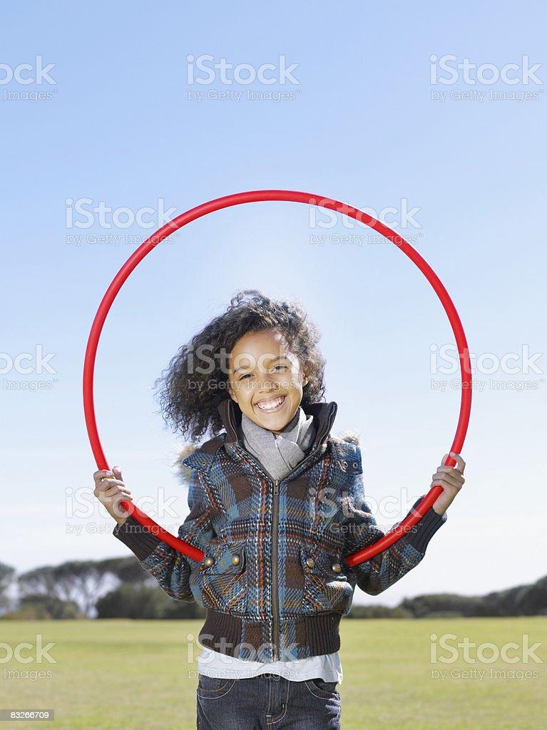 Young girl playing with hula hoop royaltyfri bildbanksbilder