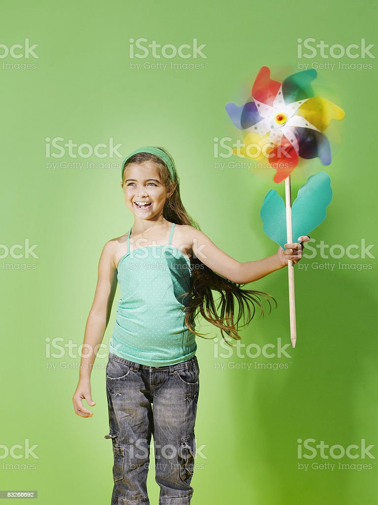 Young girl playing with pinwheel royalty free stockfoto
