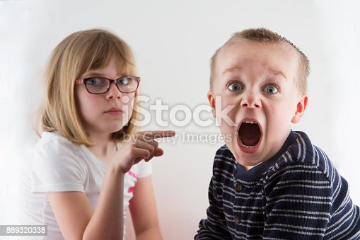istock young girl pointing at a boy 889320338