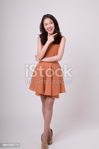 istock young girl pointing copy space 484259770