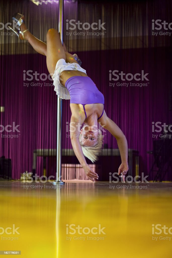 Young girl pole dancing royalty-free stock photo