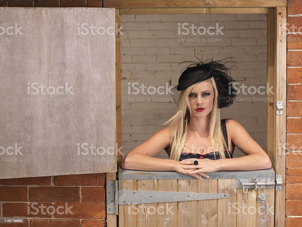 young girl posing at stable royalty-free stock photo