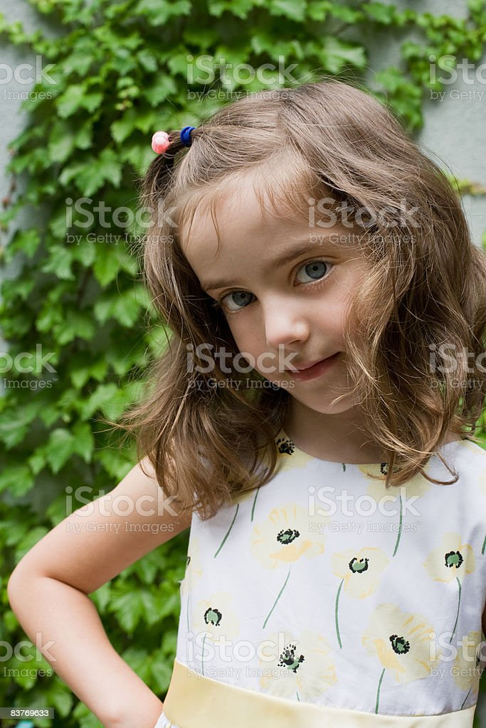 Young girl posing in a floral dress royalty-free stock photo