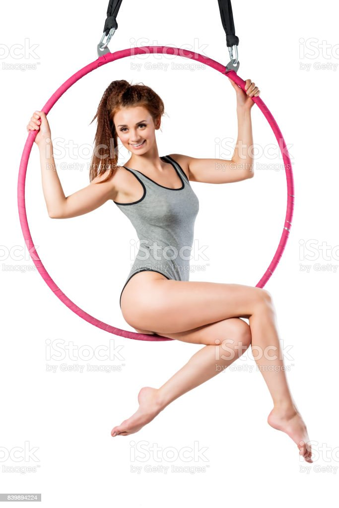 Young girl posing in an airy ring on a white background stock photo