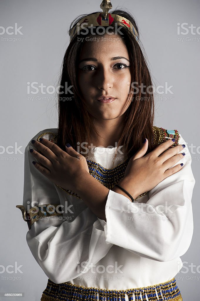 Young girl posing in egyptian clothing stock photo